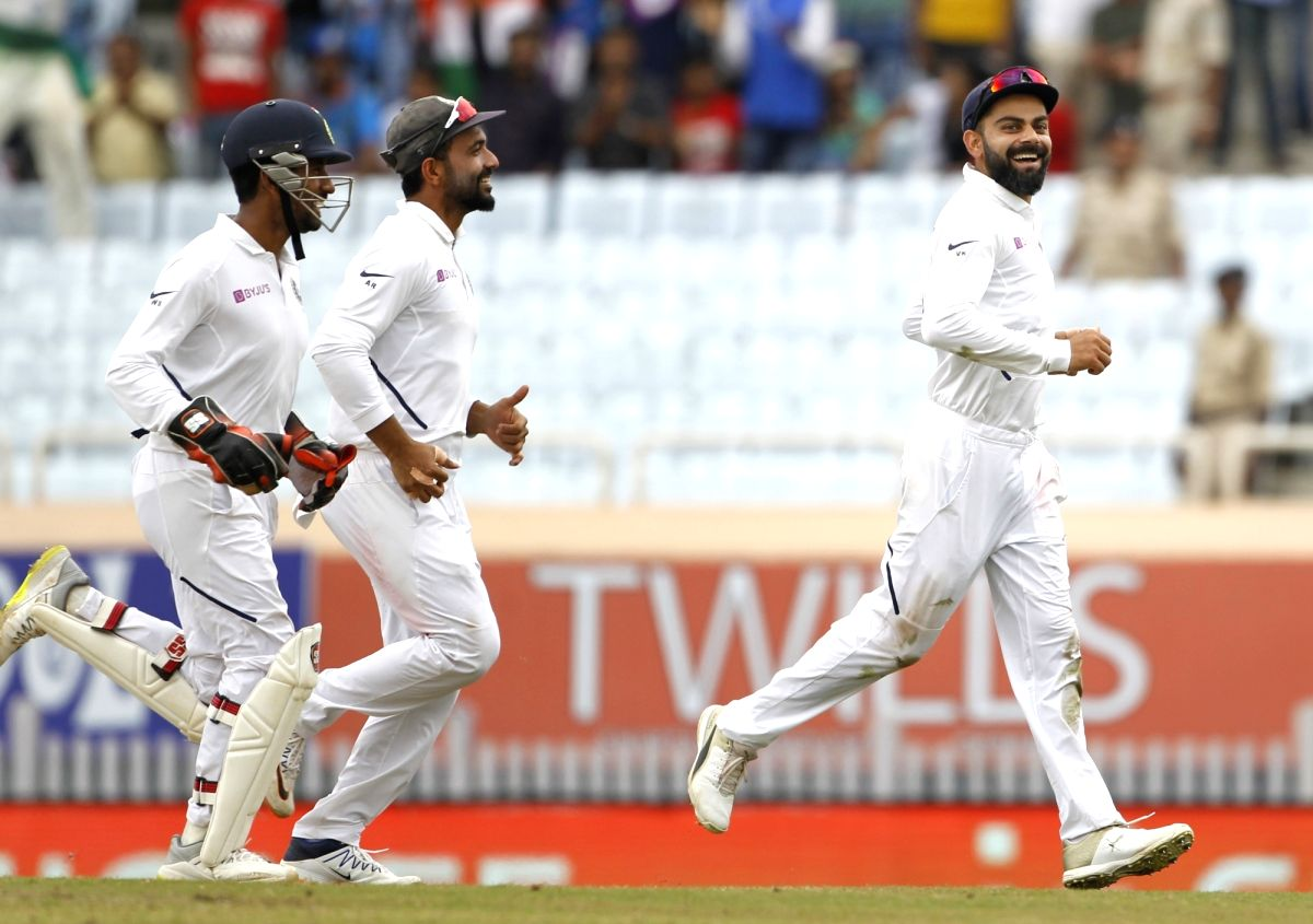 Ranchi: Indian skipper Virat Kohli celebrates the wicket of Kagiso Rabada with teammates on Day 3 of the 3rd Test match between India and South Africa at JSCA International Stadium Complex in Ranchi on Oct 21, 2019. (Photo: Surjeet Yadav/IANS)