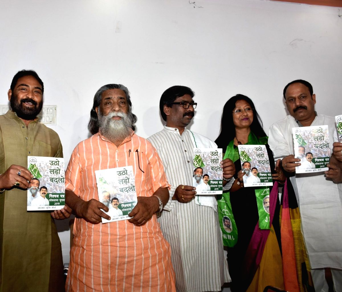 Ranchi: Jharkhand Mukti Morcha (JMM) President Shibu Soren and his son and Former Chief Minister Hemant Soren release the party's election manifesto for 2019 Lok Sabha polls, in Ranchi on April 27, 2019.