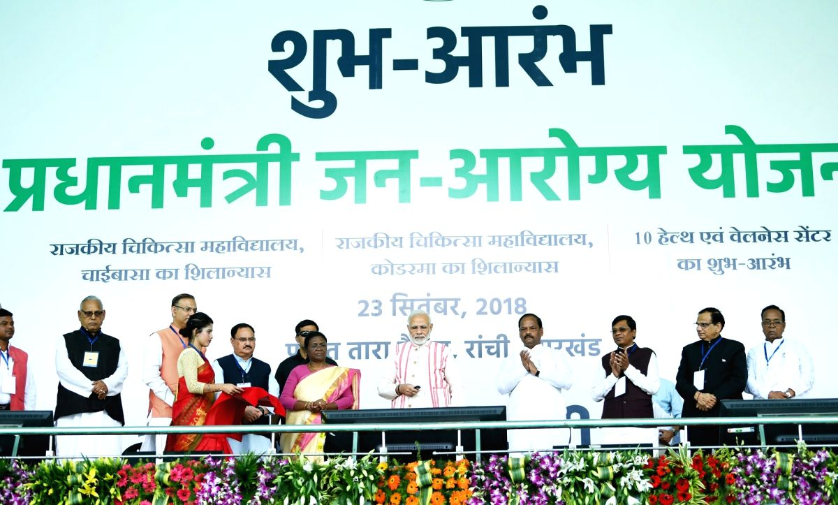 Ranchi: Prime Minister Narendra Modi launches 'Ayushman Bharat -Pradhan Mantri Jan Aarogya Yojana (AB-PMJAY)' along with Jharkhand Governor Droupadi Murmu, Chief Minister Raghubar Das and Union Health and Family Welfare J.P. Nadda on Sept 23, 2018. (