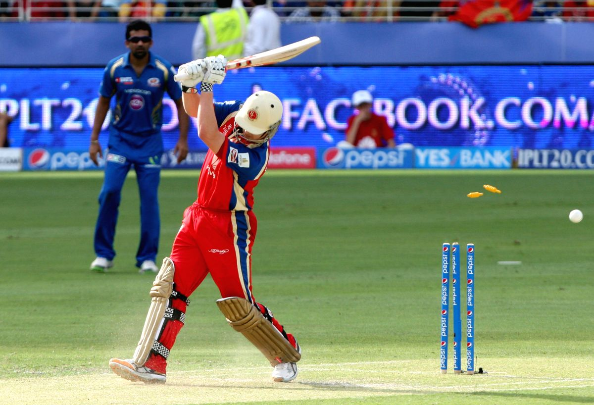 RCB player Nic Maddinson gets bowled during the fifth match of IPL 2014 between Royal Challengers Bangalore and Mumbai Indians, played at Dubai International Cricket Stadium in Dubai of United Arab Emirates on April 19, 2014.