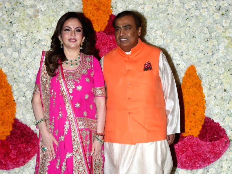 Mumbai: Reliance Industries Chairman Mukesh Ambani with his wife and Reliance Foundation Founder and Chairperson Nita Ambani at a Diwali hosted by them in Mumbai on Oct 24, 2019.