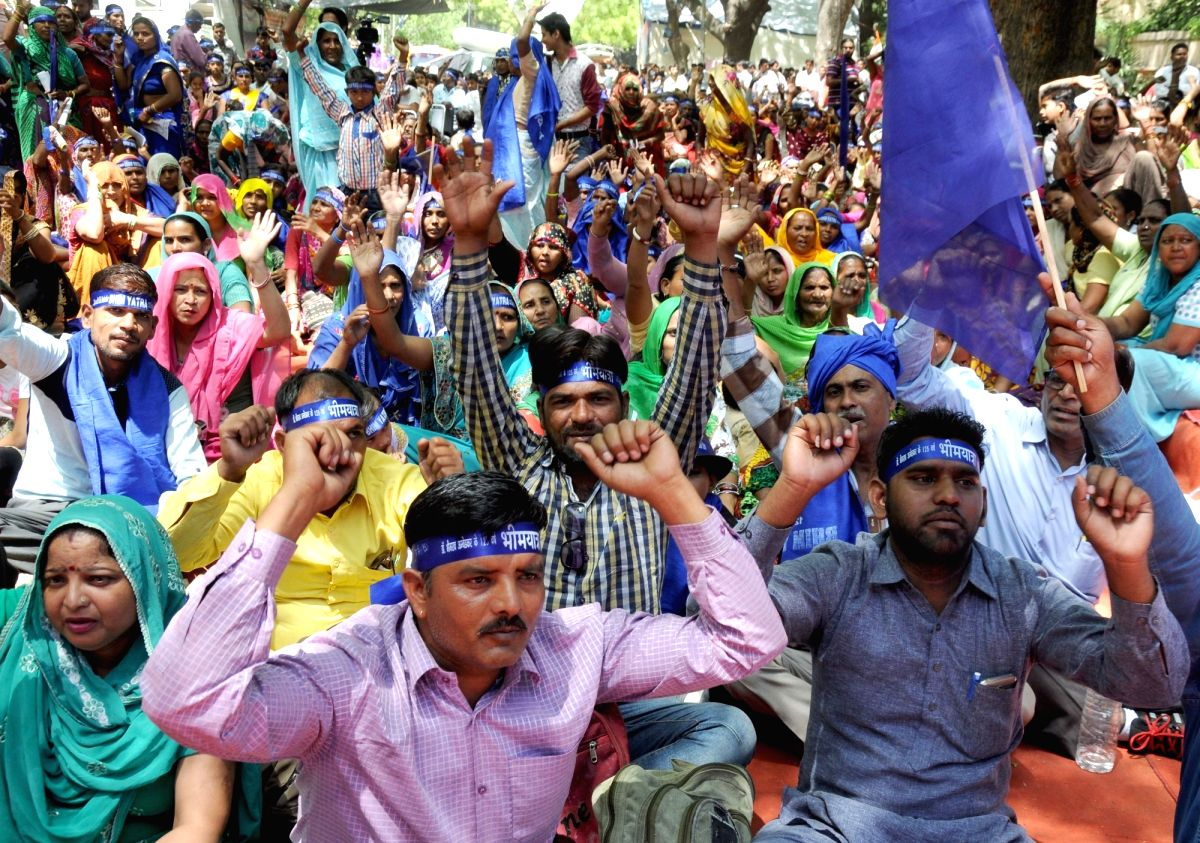 Sanitation workers stage a demonstration to press for their demands in New Delhi, on April 13, 2016.