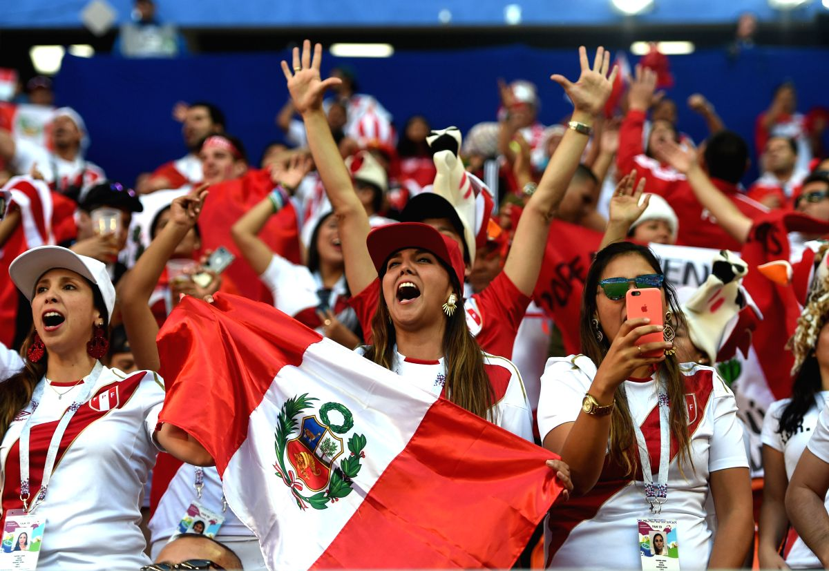 Peru fans cheering their country's team