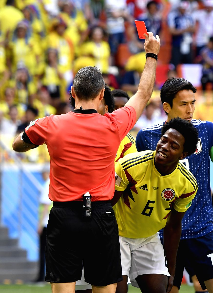 Columbia's Carlos Sanchez Moreno was given the first red flag after he blocked a shot with his arm in the match against Japan