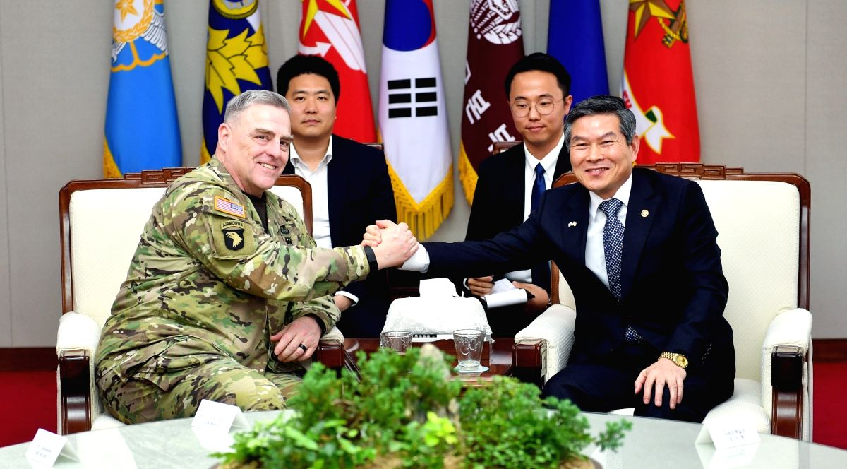 Seoul: South Korean Defense Minister Jeong Kyeong-doo (R) poses for a photo with U.S. Army Chief of Staff Gen. Mark Milley at the defense ministry in Seoul on May 2, 2019, in this photo provided by the ministry. (Yonhap/IANS)