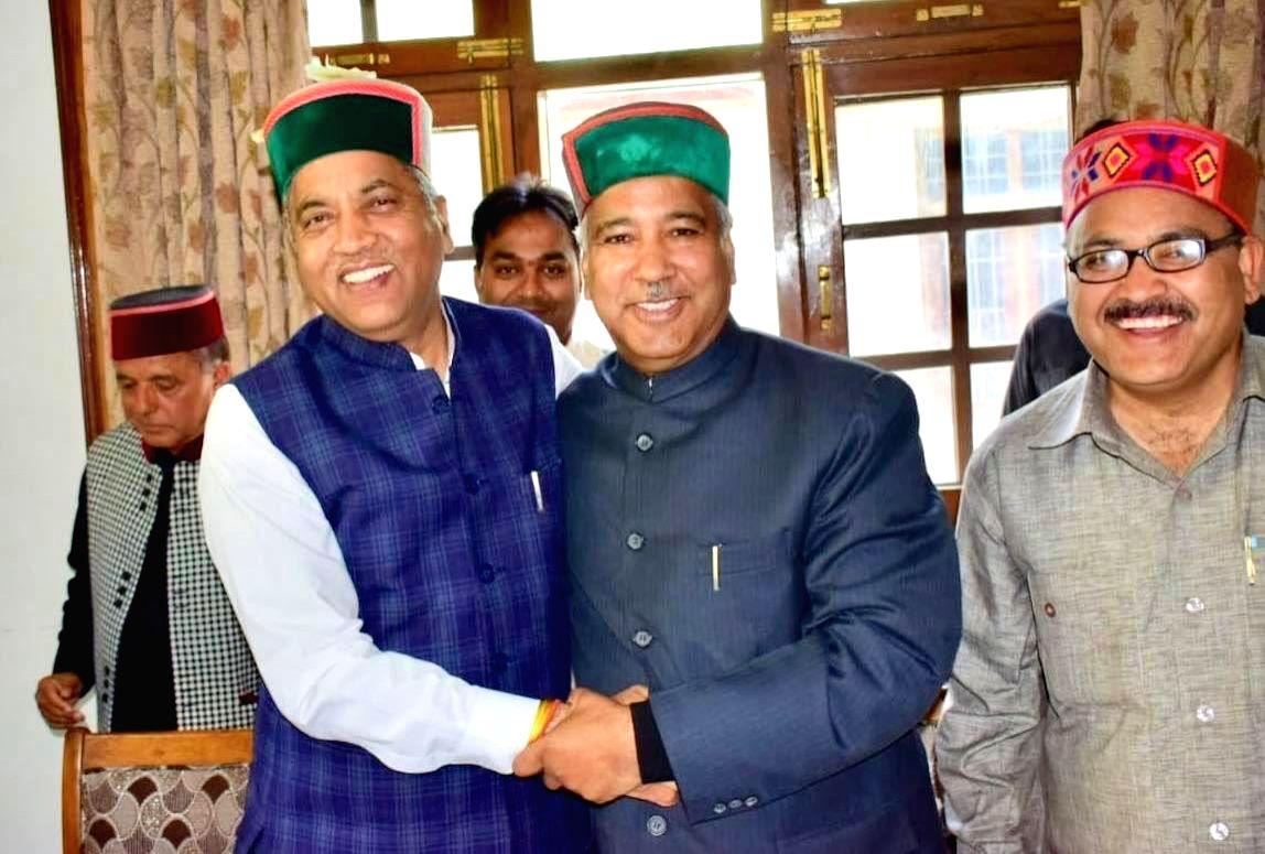 Shimla: Singhi Ram, a six-time Congress legislator from Himachal Pradesh, joins BJP in the presence of Himachal Pradesh Chief Minister Jai Ram Thakur in Shimla, on April 27, 2019.
