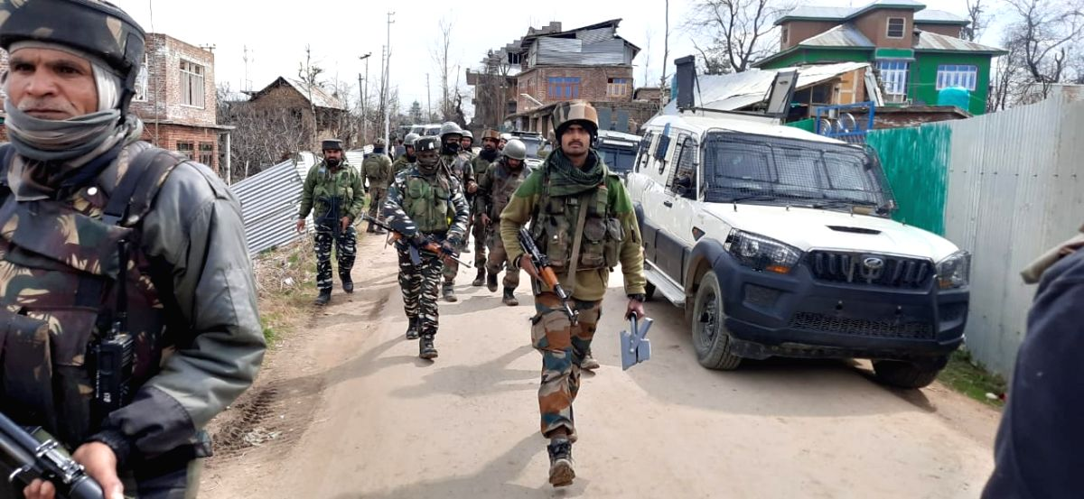 Shopian: Security personnel carry out cordon and search operations after two unidentified terrorists were killed in a shootout with the security forces and ammunition recovered from them in Jammu and Kashmir's Shopian district, on March 9, 2020. The