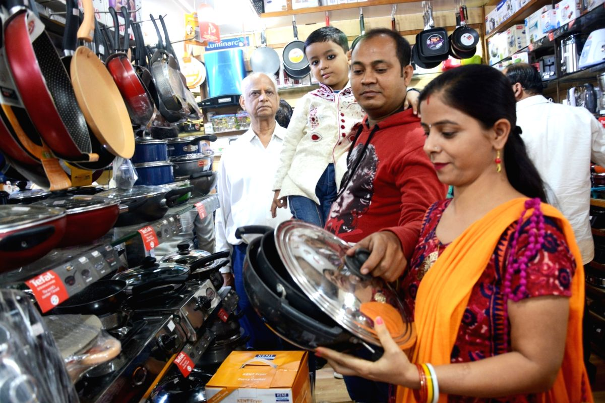 Shops fined for running business during bypolls in Lucknow.
