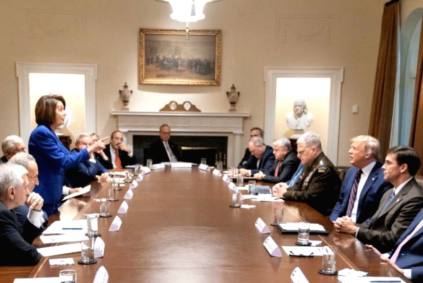 Signifying the deep political divisions in Washington, a new photo shows US House Speaker Nancy Pelosi confronting President Donald Trump at a reportedly explosive White House meeting. In the image, leading Democrat Pelosi is standing up at a large t
