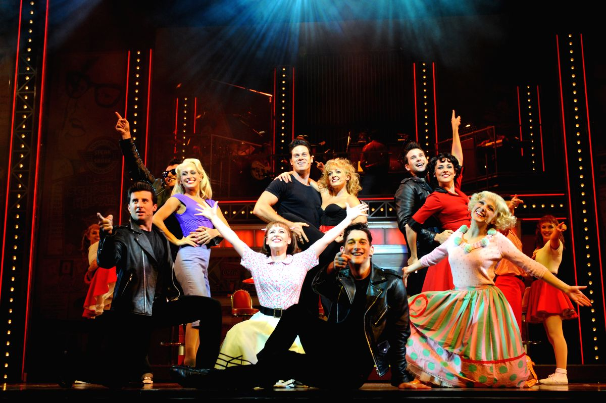 """SINGAPORE, April 25, 2014 (Xinhua) -- Performers perform in the musical """"Grease"""" during a media call in Singapore's Marina Bay Sands Theatre on April 25, 2014. The musical """"Grease"""" opens in the Marina Bay Sands Theatre on Friday. (Xinhua/Then Chih We"""