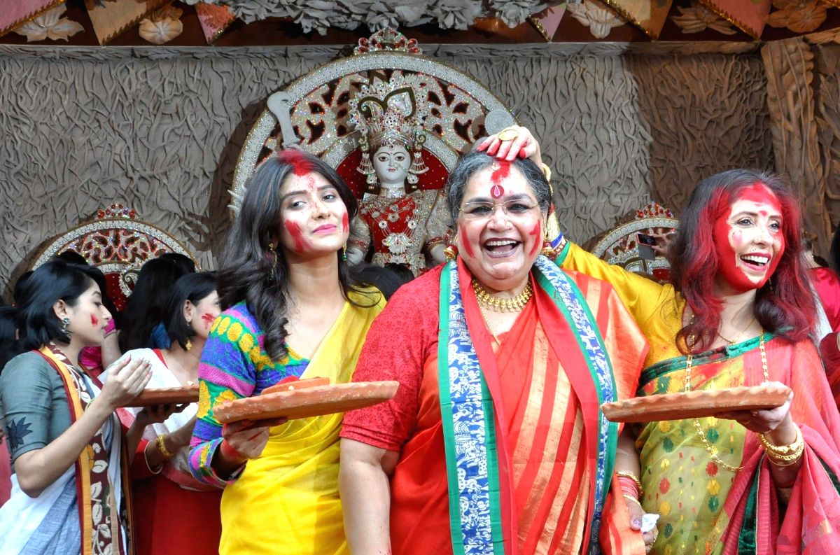 Seen here is Usha Uthup and other celebrities having fun at Sindoor Khela