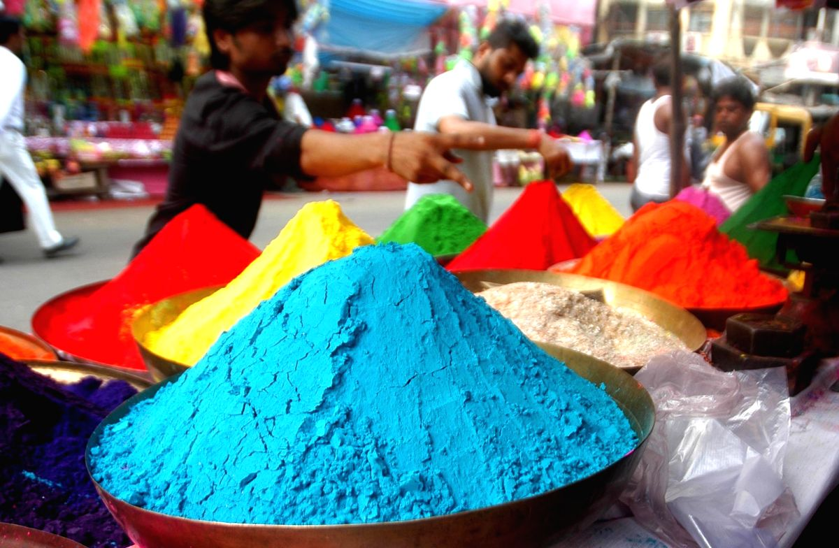 Smalltime traders sell colors ahead of Holi in Kolkata.