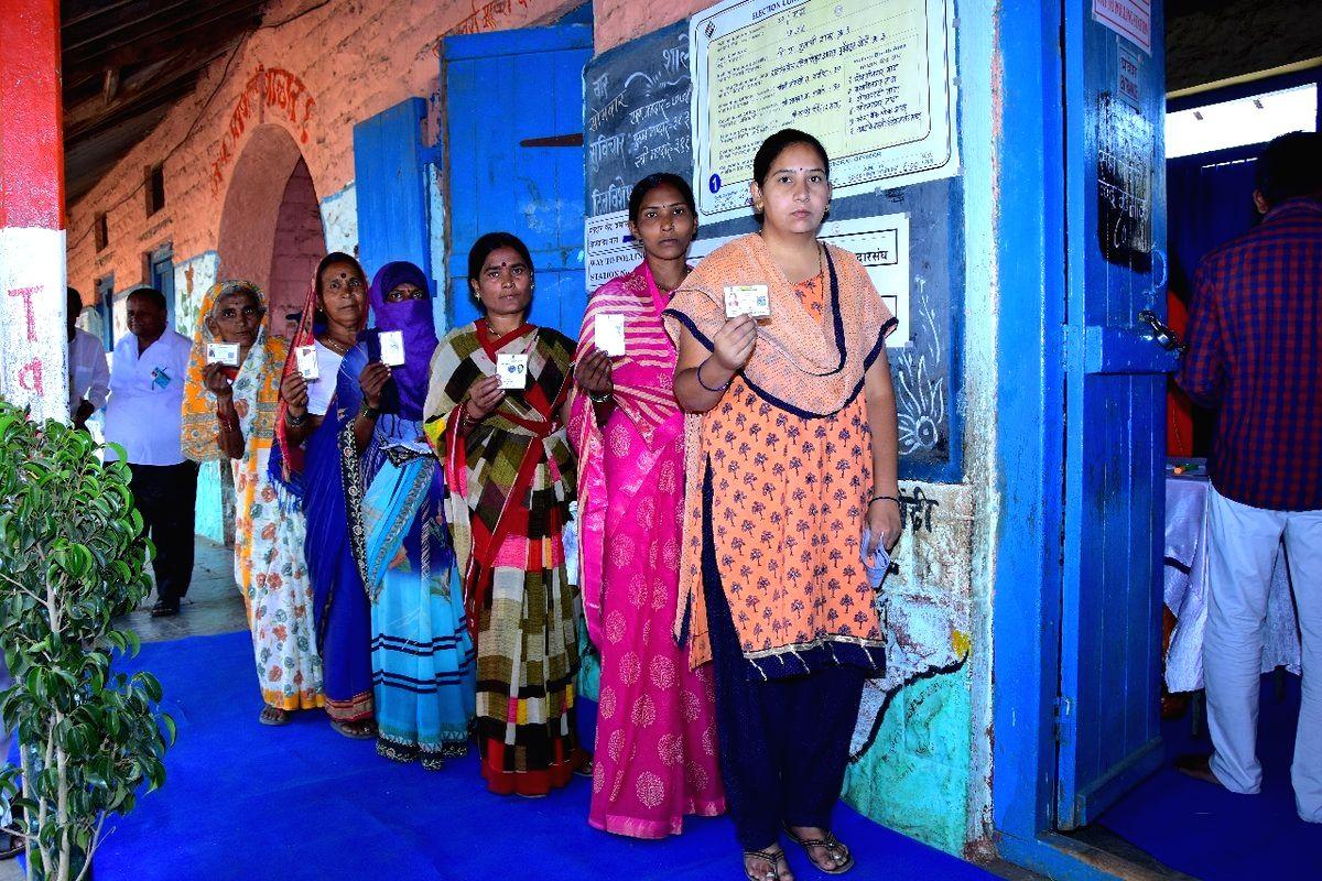 Solapur (Maharashtra): Women voters wait in a queue to cast their votes for the third phase of 2019 Lok Sabha elections in Maharashtra's Solapur, on April 23, 2019. (Photo: IANS/PIB)