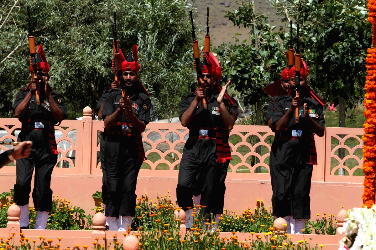 Soldiers paying tributes at the war memorial during a function to celebrate 14th anniversary of Kargil War victory at Drass, Kargil on Friday July 26, 2013.