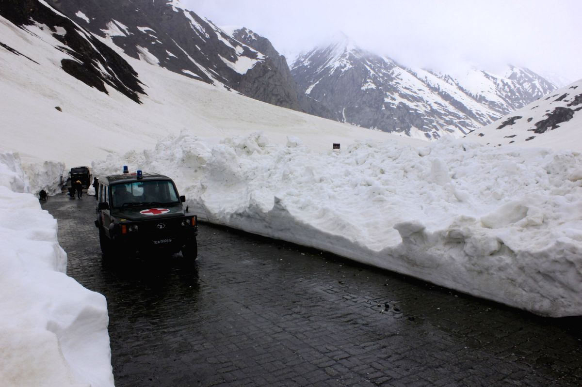 Sonamarg: Vehicles ply on  Srinagar-Leh highway which was thrown open after remaining closed for more than five months due to heavy snowfalls; in Sonamarg on May 13, 2015.