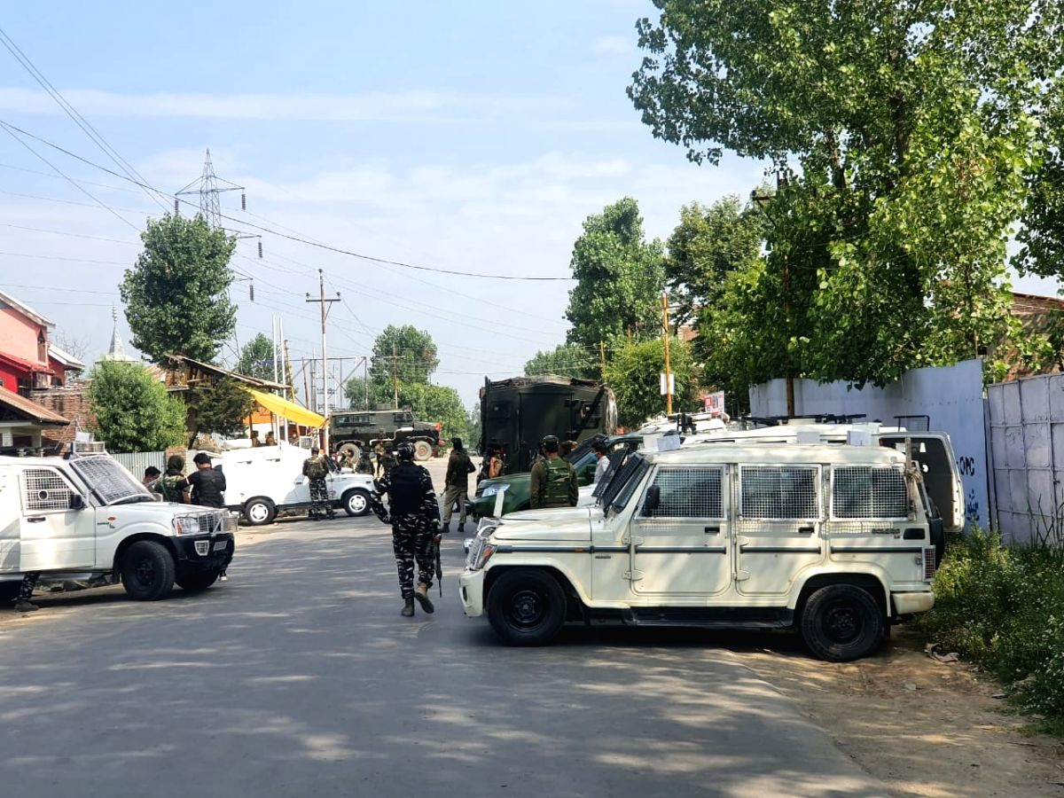 Sopore: Army personnel launch a cordon and search operation (CASO) after one CRPF Head Constable and a civilian were killed while three other security personnel were injured after terrorists attacked a CRPF party at Sopore in North Kashmir on July 1,