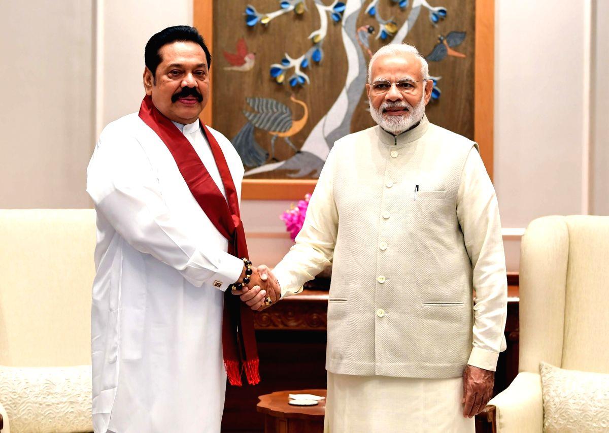 Sri Lanka Prime Minister Mahinda Rajapaksa and his Indian counterpart Narendra Modi