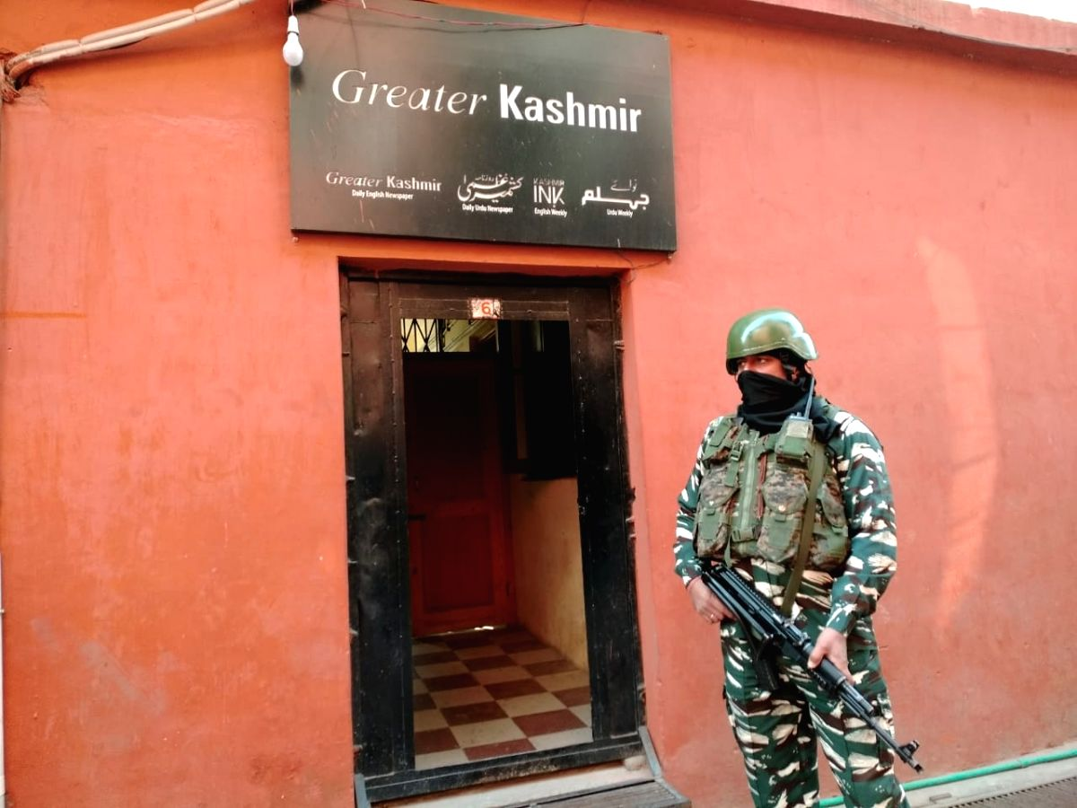 Srinagar: A security personnel stands guard as the National Investigation Agency (NIA) conducts raid at an office of a prominent English daily newspaper as part of its ongoing investigation into the terror funding case, in Srinagar on Oct 28, 2020. (