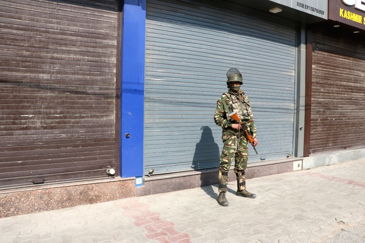 : Srinagar: A soldier stands guard on a Srinagar road during a protest shutdown called by Joint Resistance ership (JRL), a separatist conglomerate headed by Syed Ali Geelani, Mirwaiz Umer Farooq ...