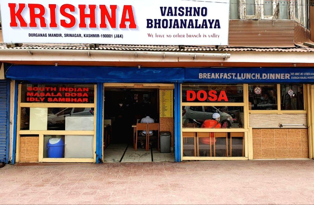 Srinagar: Owner reopens famous Srinagar eatery 2 months after terrorists killed son.(Photo:Nissar nice Malik/IANS)