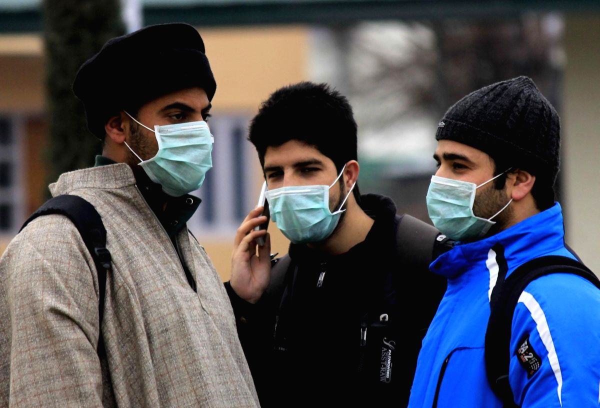 Srinagar: People wear masks as a protective measure against swine flu in Srinagar.