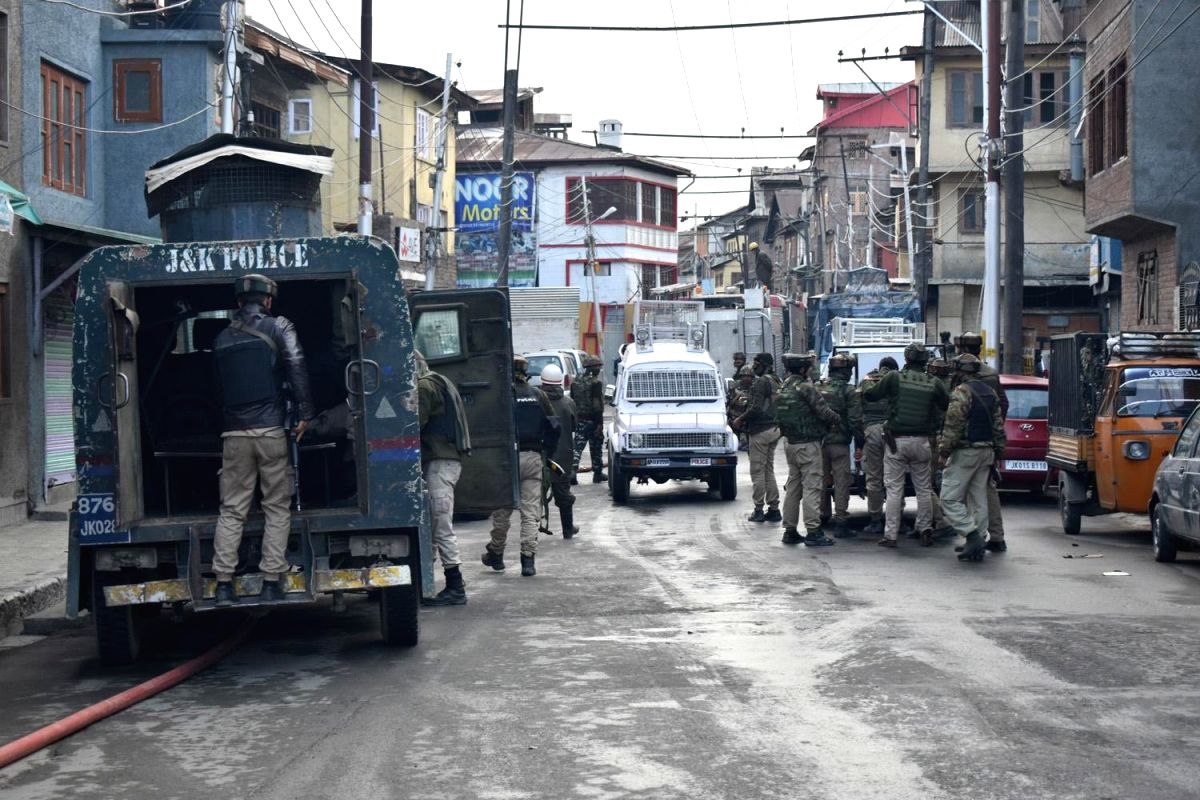 :Srinagar: Security beefed up at the site where a gun fight erupted between holed up militants and the security forces in Srinagar's Fateh Kadal area in which a policeman and three militants ...