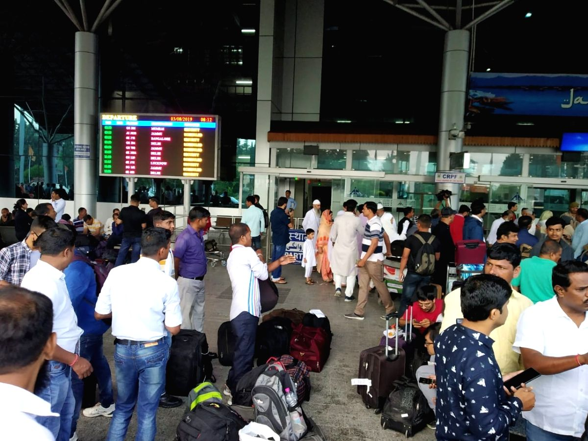 Srinagar: Tourists at Srinagar airport on Aug 3, 2019. According to government sources, airlines have been advised to free up capacity that can be quickly deployed to the state so that tourists and pilgrims can be flown-out of Jammu and Kashmir. On t