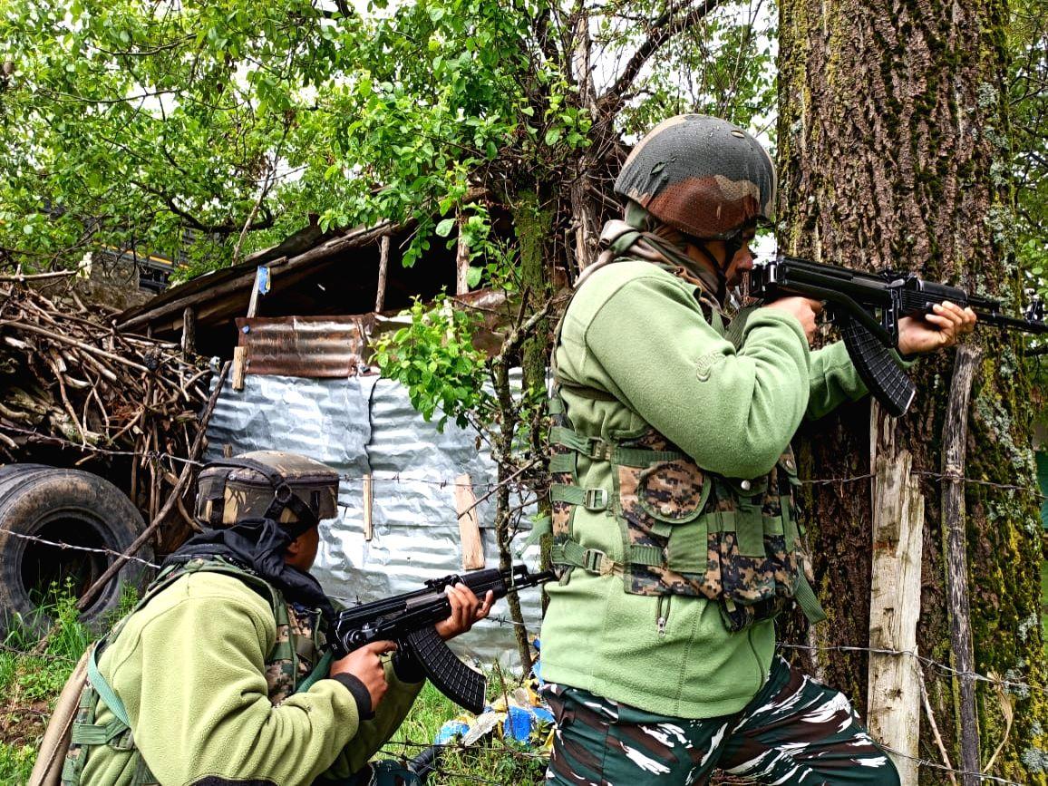 Srinagar: Two more terrorists have been killed in an ongoing encounter at Vailoo, Kokernag in South Kashmir's Anantnag district on Tuesday, taking the toll of terrorists killed in the encounter to three, officials said.(Photo: Nisar Malik /IANS)