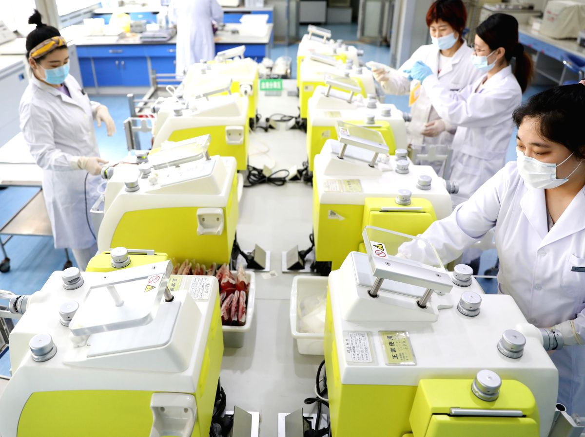 Staff members work at Anshan Red Cross Blood Center in Anshan, northeast China's Liaoning Province