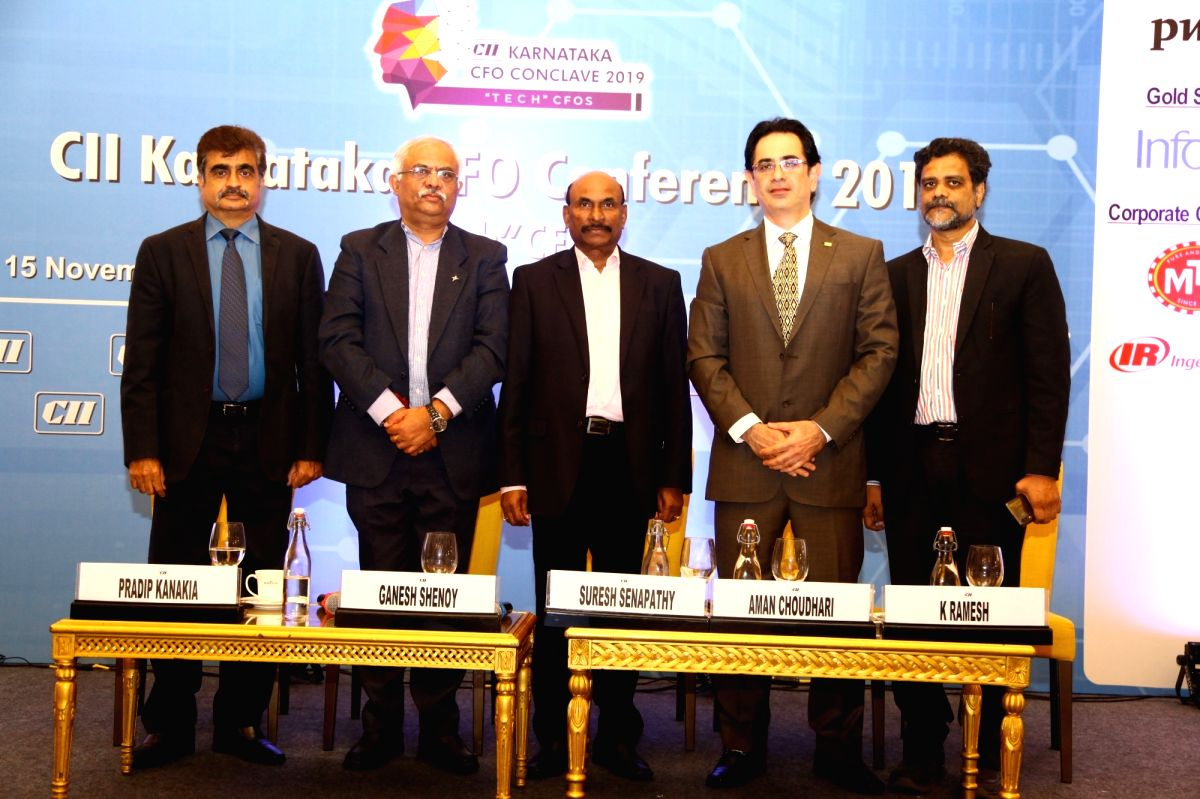 Suresh Senapathy, centre, flanked by CFOs at the CII CFO Conclave 2019 in Bengaluru on Friday.