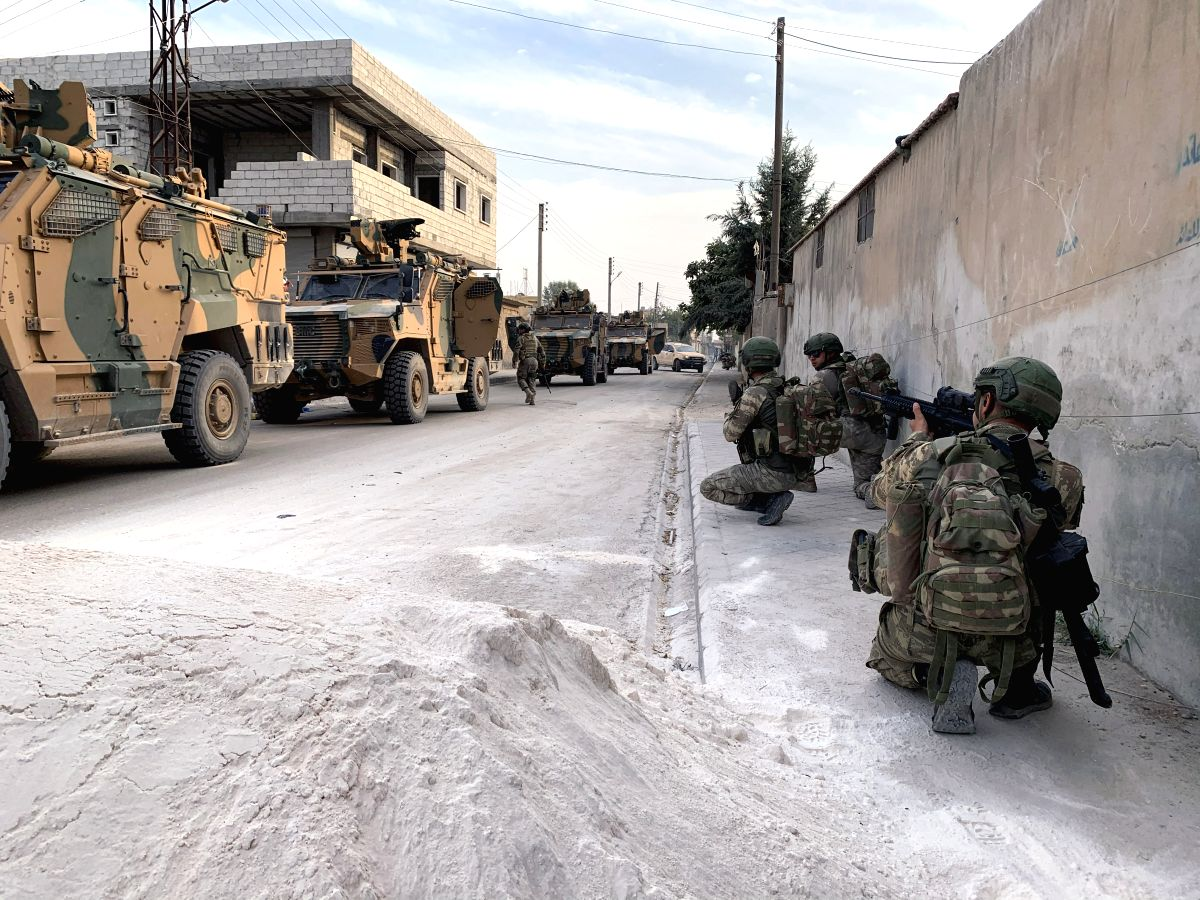 TAL ABYAD, Oct. 19, 2019 (Xinhua) -- The Turkish forces are seen in Tal Abyad in northern Syria, Oct. 18, 2019. Turkish President Recep Tayyip Erdogan said on Friday that Turkey expects the Kurdish militia to leave within 120 hours the safe zone to b