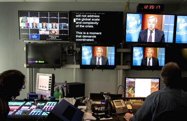 Technicians at the United Nations monitor a virtual news conference by Secretary-General Antonio Guterres on March 19, 2020. The reporters participating in the news conference are on the screen at top left. (Photo: UN/IANS)
