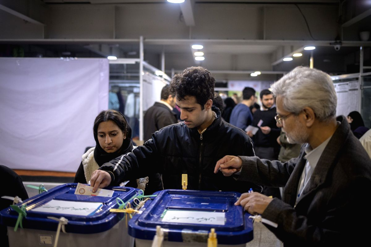 TEHRAN, Feb. 21, 2020 (Xinhua) -- People vote at a polling station in Tehran, Iran, Feb. 21, 2020. Voting began in the Iranian parliamentary election on Friday as supreme leader Ayatollah Ali Khamenei was seen cast the first vote on the state televis