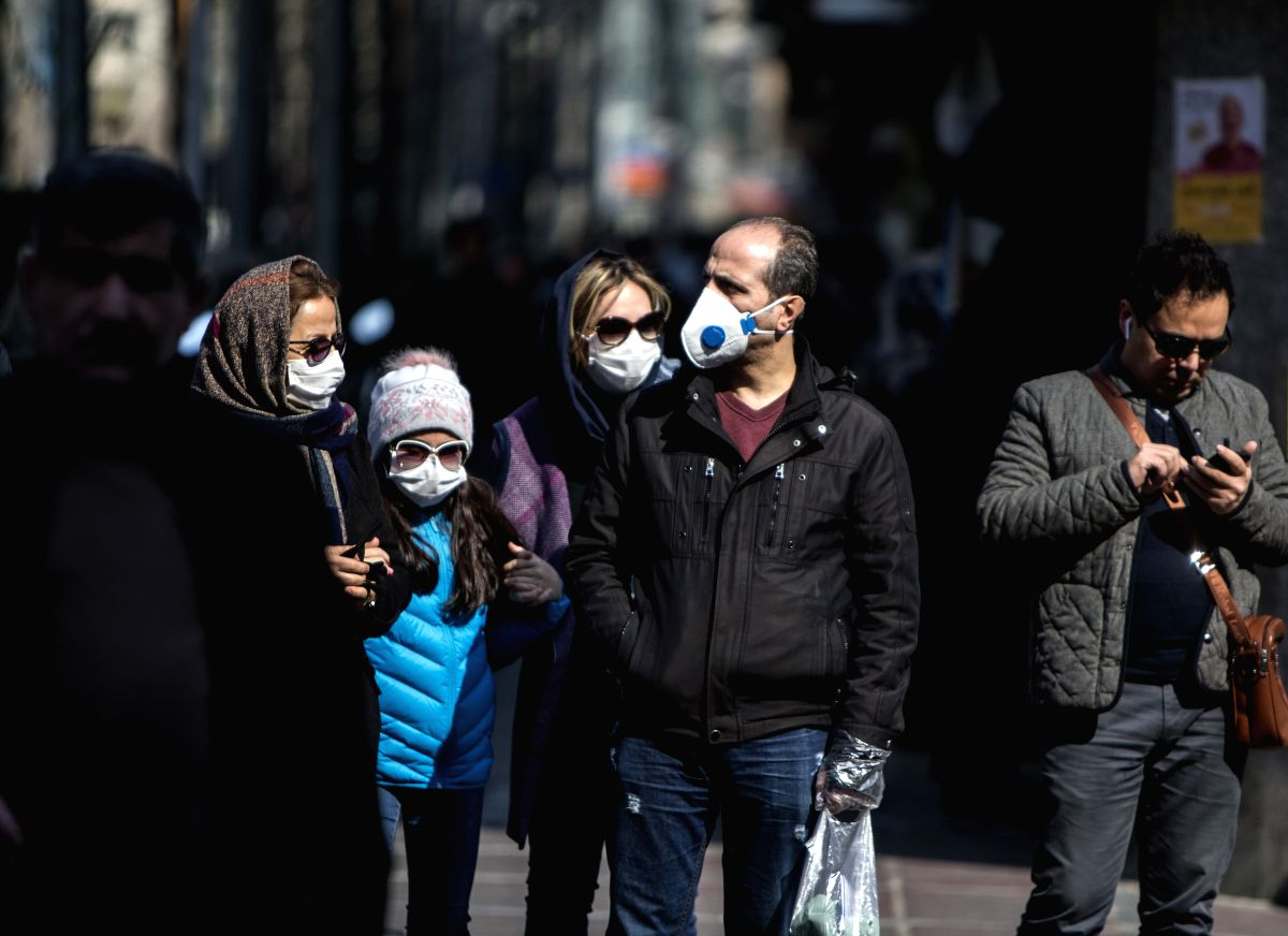TEHRAN, Feb. 24, 2020 (Xinhua) -- People wearing masks walk in downtown Tehran, Iran, Feb. 23, 2020. Iranian President Hassan Rouhani on Sunday issued an order to form a national headquarters to cope with the outbreak of the novel coronavirus in the