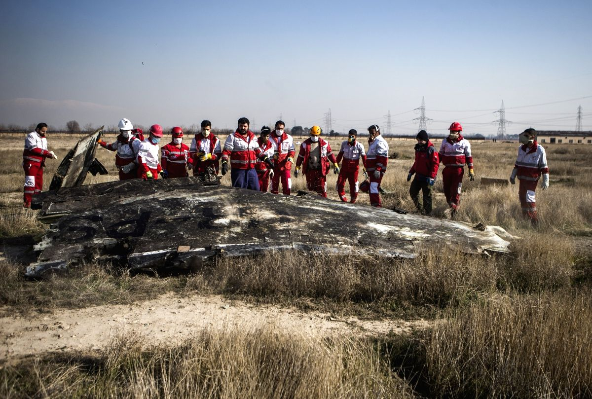 TEHRAN, Jan. 8, 2020 (Xinhua) -- Rescuers work at the air crash site of a Boeing 737 Ukrainian passenger plane in Parand district, southern Tehran, Iran, on Jan. 8, 2020. All the passengers and crew members on board the Boeing 737 Ukrainian passenger