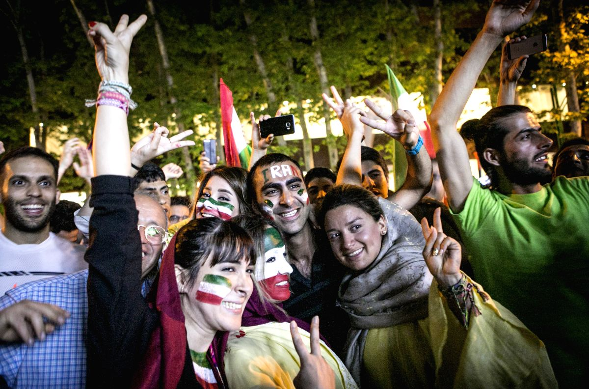 Iranian fans celebrate after Iran's victory over Morocco