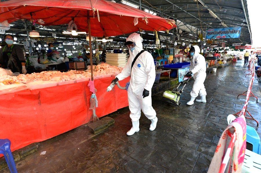 Thailand, Dec. 23 (Xinhua) -- Staff spray disinfectant in a market in Samut Sakhon province, Thailand, Dec. 21, 2020. (Xinhua/Rachen Sageamsak/IANS)