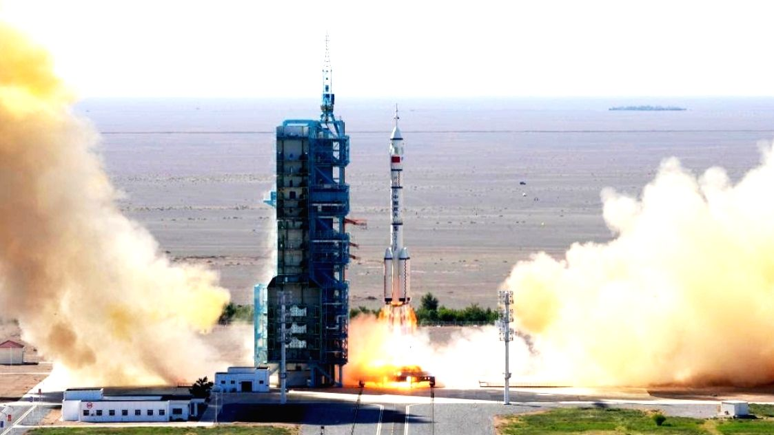 The crewed spacecraft Shenzhou-12, atop a Long March-2F carrier rocket, is launched from the Jiuquan Satellite Launch Center in northwest China's Gobi Desert, June 17, 2021. (Xinhua/Li Gang/IANS)
