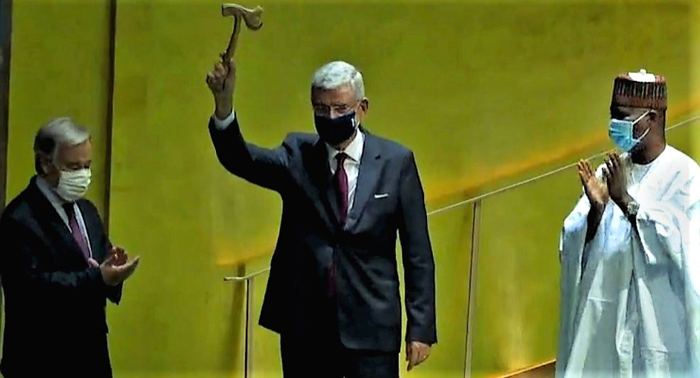 The president of the 75th session of the United Nations General Assembly Volkan Bozkir holds aloft the chamber's gavel, which was handed over to him by Tijjani Muhammad-Bande, the president of the previous session, right, on Tuesday, September 15, 20