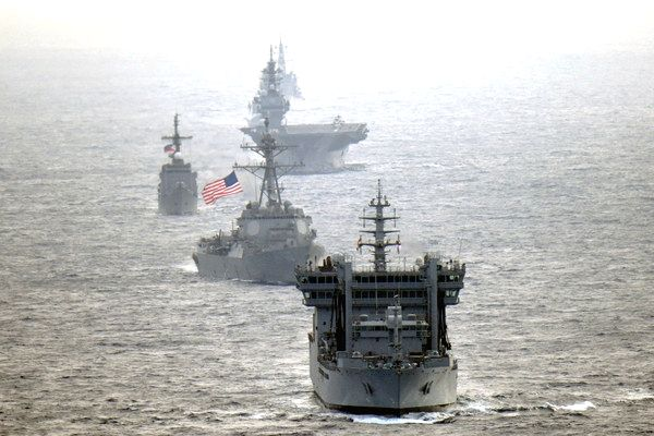 The United States Senates wants the government to increase cooperation with India in multilateral frameworks. Indian Navy destroyer INS Kolkata and tanker INS Shakti, transits the international waters in the South China Sea along with along with US N