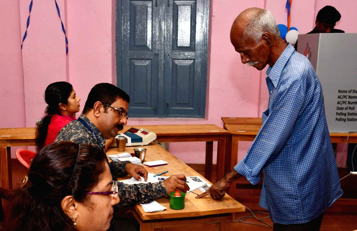 Thiruvananthapuram: A voter gets inedible ink administered by a polling official, after casting vote for the third phase of 2019 Lok Sabha elections in Thiruvananthapuram, Kerala on April 23, 2019. (Photo: IANS/PIB)