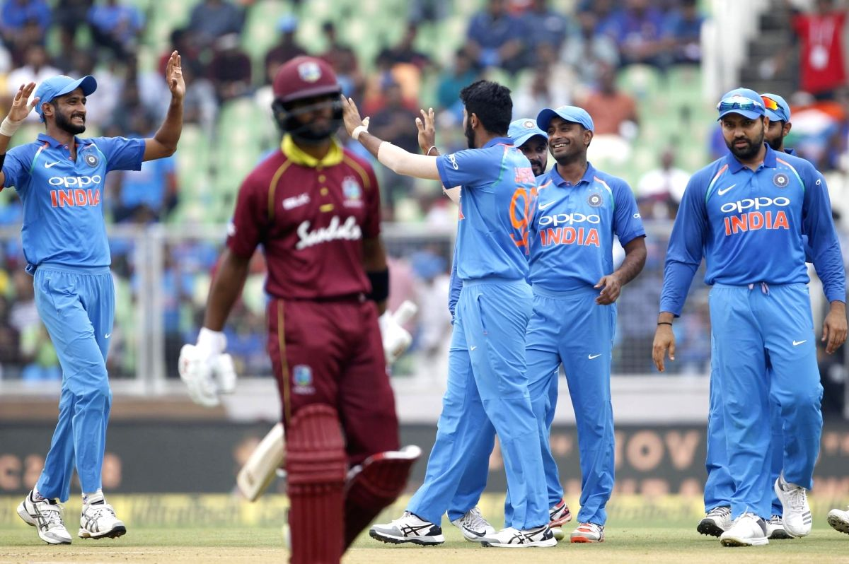 : Thiruvananthapuram: Indian players celebrates fall of wicket of West Indies batsman Shai Hope during the fifth and final One-Day International (ODI) match between India and West indies in ...