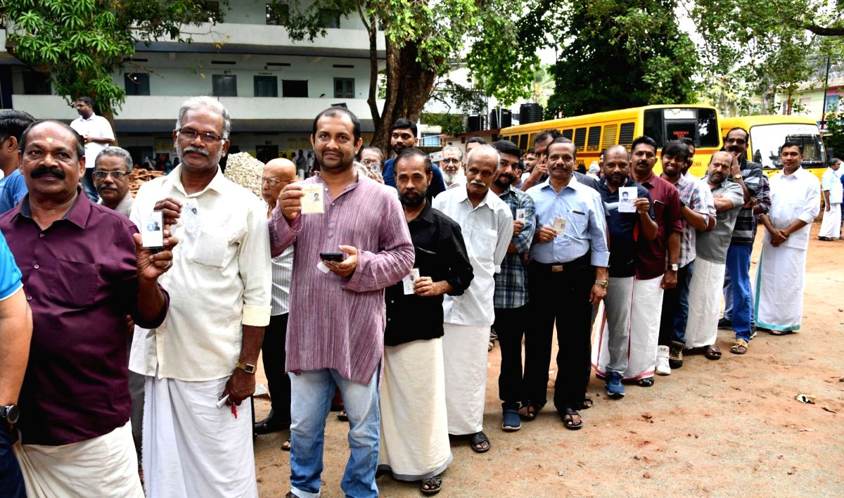 Thiruvananthapuram: Voters wait in queues to cast their votes for the third phase of 2019 Lok Sabha elections in Thiruvananthapuram, Kerala on April 23, 2019. (Photo: IANS/PIB)