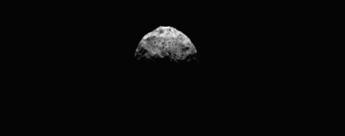 This image shows a top-down view of asteroid Bennu, with a portion of the asteroid's equatorial ridge and northern hemisphere illuminated.It was taken by the PolyCam camera on NASA's OSIRIS-REx spacecraft on March 4, 2021, from a distance of abou