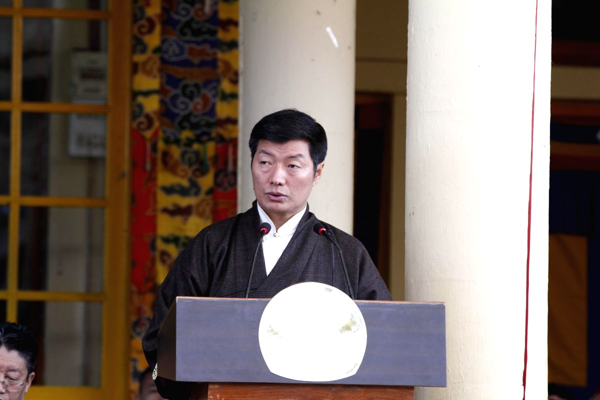 :Tibetan government-in-exile Prime Minister Lobsang Sangay addresses during a programme held to commemorate 24th anniversary of the conferment of the Nobel Peace Prize to Dalai Lama, at Tsugla ...