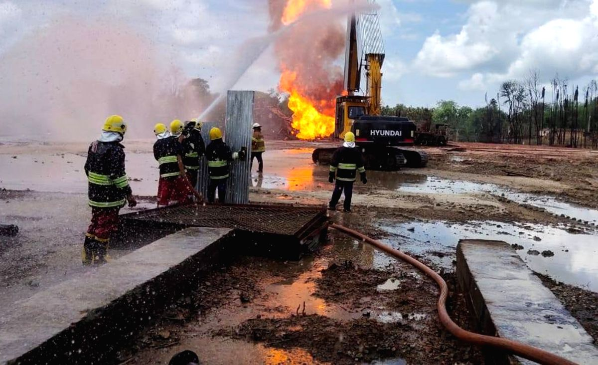 Tinsukia: Oil India Limited (OIL) workers engaged in operations to put out the fire and cap the leaking oil well in Baghjan in Tinsukia district of Assam on July 3, 2020. A massive fire broke out on June 9 at OIL's Baghjan oil well near the Dibru-Sai