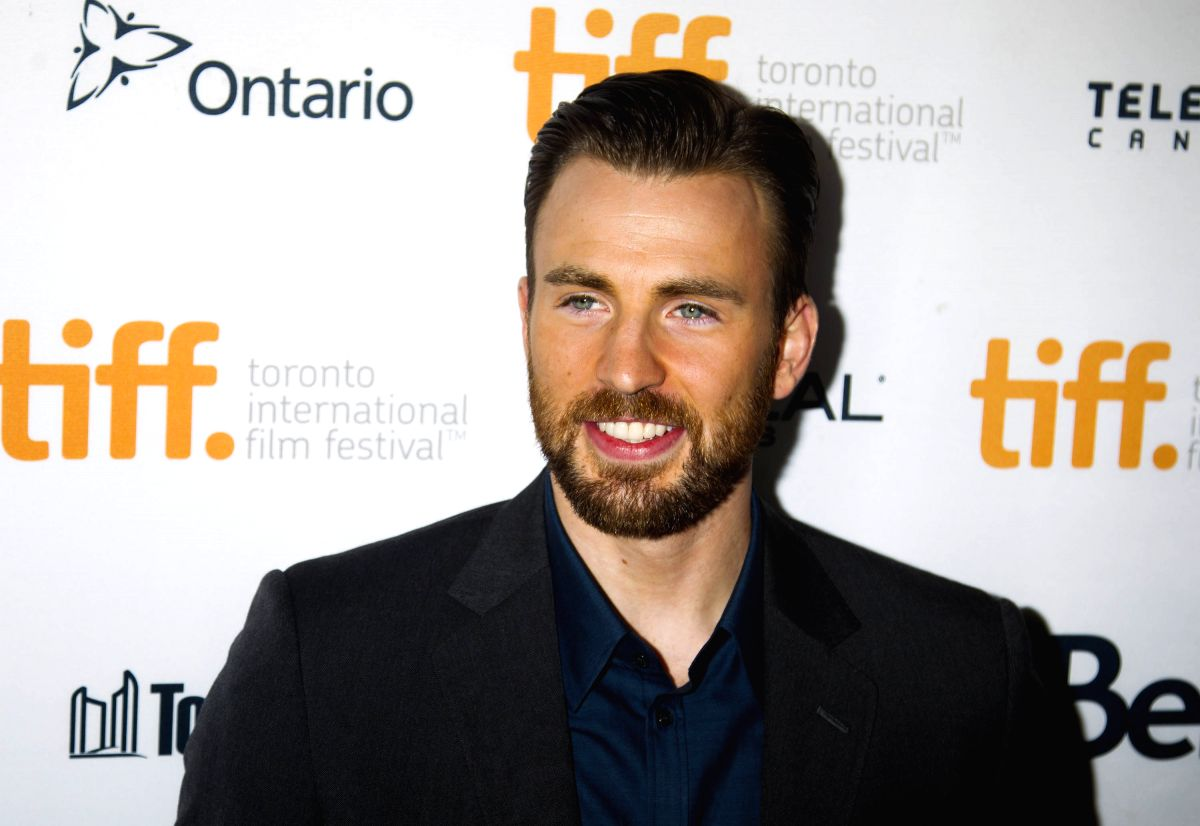 """TORONTO, Sept. 13, 2014 (Xinhua) -- Director and actor Chris Evans poses for photos before the world premiere of his directorial debut """"Before We Go"""" at the Princess of Wales Theater during the 39th Toronto International Film Festival in Toronto, Can"""