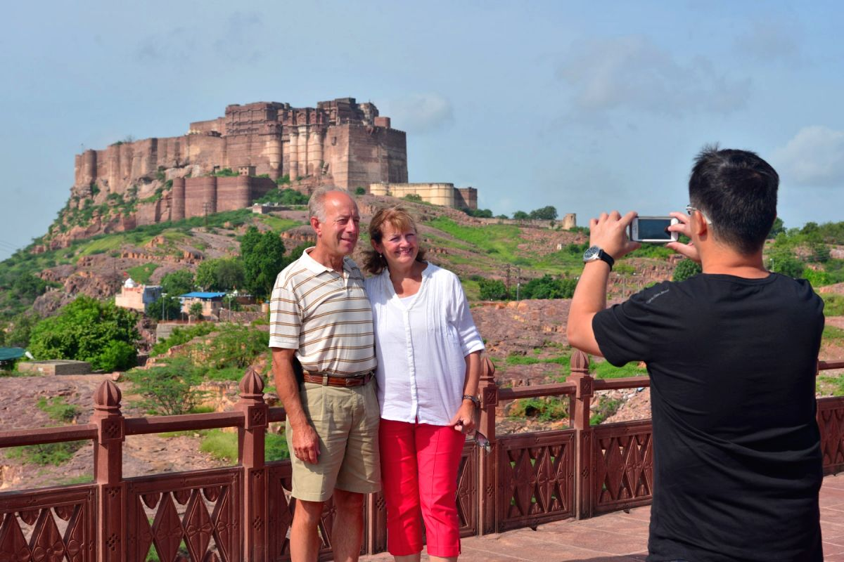 Tourists click pictures in front of Mehrangarh Fort in Jodhpur