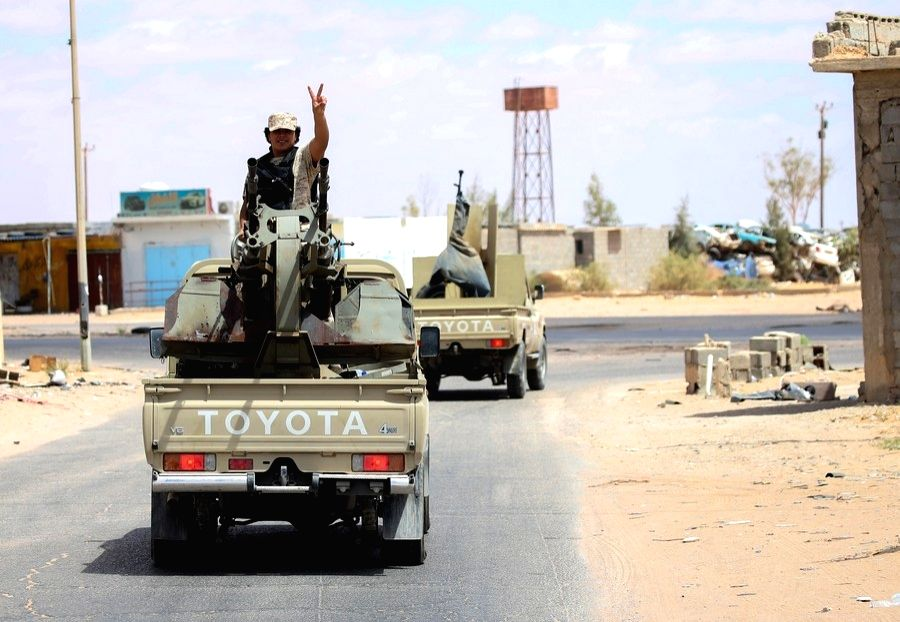 Tripoli, July 20, 2020 (Xinhua) -- A fighter of the UN-recognized Libyan government gestures on a pickup truck in the Abu Qurain area about 300 kilometers east of the Libyan capital Tripoli, July 20, 2020. (Photo by Hamza Turkia/Xinhua/.IANS)