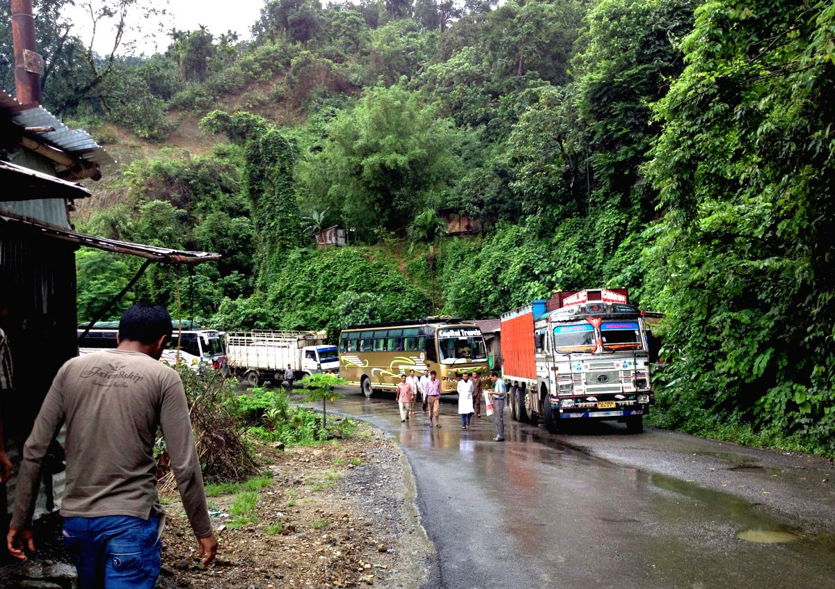 Tripura: Vehicles remain stranded on the National Highway 44, on Tripura-Assam border due to a landslide on the lone road connecting the two states, on June 14, 2015.